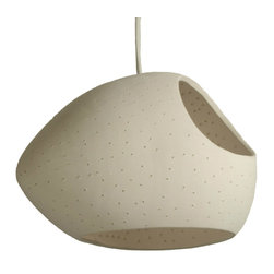 Lightexture - Claylight Double Cut - Made by ceramic artist Sharan Elran, this asymmetrical, egg-shaped pendant light features two openings, for extra illumination. The white perforated shell glows like a constellation, casting flickers of light across the room (and smiles across the faces of your guests).