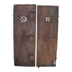 Iron Garden Gates - Found in a village, a matching pair of beautiful antique cast iron gates.Great for ornate garden prop or to repurpose back into functioning gates. Detailed with peep holes, leaves, rosettes and huge locks.