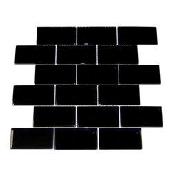 """Spa Glass - Black 2X4 Subway Glass Tile, Black, 2x4, Carton - CARTON of Black 2X4 subway glass tile consisting of 20 square feet or sheets. This tile is manufactured in a thinner 1/8 inch thick format and is a high quality """"POOL RATED"""" glass subway tile that is perfect for a kitchen backsplash, bathroom tile, shower tile or pool tile. Because the tiles are thinner and come mesh mounted in a staggered interlocking brick pattern, installation is much easier and much less expensive. The thinner profile eliminates the need for tear outs or large demolitions. You can tile over existing materials and eliminate installation cost ( think DIY).These are a very high grade glass subway tile kilned at 800 Celsius for maximum durability and come with a baked polypropylene backing which reflects the color back thru a very clear glass.  The tiles come in a 12X12 inch sheet consisting of 18 tiles 2X4 inches in size.  They come in boxes of 20 square feet or 20 sheets. There is also a SAMPLE option so you can confirm the color is perfect for your space. The Price listed is for a single CARTON OF 20 SQUARE FEET."""