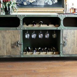 Modern Industrial Furniuture - This industrial style wine cabinet / sideboard is built to emulate an old vintage metal tool chest. However now it can hold bottles of wine, wine glasses and offers plenty of storage to store serving plates, dinnerware, glassware or even large punch bowls.