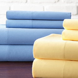 Hotel New York - Blue & Yellow 600-Thread Count Sheet Set - For blissful nights of rest, surround yourself in the ultimate comfort of these luxurious sheets that offer a versatile look for a variety of bedding styles.   Includes two flat sheets, two fitted sheets and four pillowcases Fits mattresses up to 18'' deep 60% cotton / 40% polyester 600-thread count Machine wash Imported