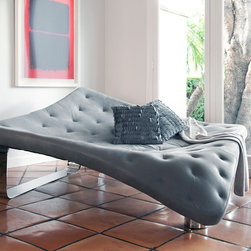 Stingray - By distilling the graceful flowing lines of this cartilaginous fish into simple geometric forms, this daybed takes on an elegant weightless stance reminiscent of a stingray swimming. The large undulating surface allows multiple people to sit, lie or sprawl as they please.