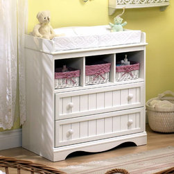 South Shore - White Finish Cottage Style Changing Table - This white finished changing table is perfect for a cottage style nursery, and offers ample and practical storage in its two drawers and three cubbyholes with baskets. This affordable changing table will make your life with baby more convenient, and grow with your child to serve as a functional storage piece later. Time-honored style and meticulous craftsmanship combine pleasingly in the Andover South Shore Changing Table. Constructed of sturdy particleboard and finished in warm Vanilla Cream, this versatile Changing Table features two wide drawers and three convenient shelves to store clothing and supplies. Start your baby's room off on the right foot with this gorgeous Changing Table. * Manufactured from eco-friendly, EPP-compliant laminated particle boardcarrying the Forest Stewardship Council (FSC) certification. Constructed of particleboard with a Pure White finish. Removable Changing Table. Assembly requiredComplete assembly required by 2 Adults. 5-year manufacturer's limited warranty. 37 H x 25 W x 20 D in.