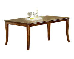 Steve Silver - Montreal Table - Set the mood for formal or casual dining depending on the occasion with the Montreal table from Steve Silver. In ash veneers and select hardwoods, this versatile table has superb corner-blocked construction with tongue and groove joints. With the addition of the 18 in.  leaf you can comfortably set the table for six.