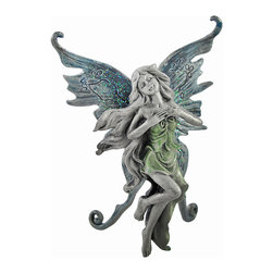 Hand Painted Pewter Standing Fairy Figurine Green Dress - This beautiful solid pewter standing fairy figurine features a hand-painted green dress and blue glitter butterfly wings. The pretty fairy measures 4 3/4 inches tall, 2 2/4 inches wide and 2 inches deep. The detail is impressive, from the markings on her wings to her long flowing hair. This gorgeous fairy statue is a perfect gift for fairy lovers young and old.