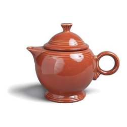 Fiesta Paprika Covered Teapot - 44 oz. - About FiestaAmerica's favorite dinnerware line, Fiesta was introduced by the Homer Laughlin China Company in 1936. Available in plenty of bright, vibrant colors and unique shapes, Fiesta dinnerware and serveware features Art Deco-style concentric rings. Made from durable, restaurant-quality ceramic and finished in lead- and cadmium-free glazes, this line of kitchenware is easy to mix and match to create your own custom set. Best of all, each piece is microwave- and oven-safe, and dishwasher-safe for easy cleanup.