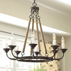 "Ballard Designs - Laurenza 8 Light Chandelier - Includes 5"" ceiling canopy and 6' hanging chain. Hand finished. It has everything we look for in a hanging fixture great presence and a sense of age, all layered with rich textures. Four hanging stems are hand wrapped in jute cord and support a black rust-finish ring of blooming candle cups with faux glass antique white drip candle sleeves. Laurenza Chandelier features:. ."