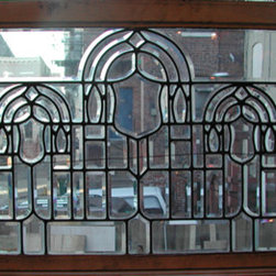 """Beveled Glass Window - 97 pieces of beveled glass forming a triple arch with shields. 34""""W x 25 1/2""""H c.1900"""