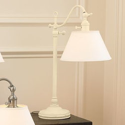 """CFL Adair Bedside Lamp, Distressed Antique White - A vintage streetlight design inspired our Adair Bedside Lamp. 15.5"""" wide x 9"""" deep x 20.5"""" high; adjusts to 24"""" high. Distressed Antique White are crafted of solid iron; Bronze is crafted of solid brass; felt protective bottom. Adjust height and angle with the turnkey. White linen shade is included. Title 20 compliant lamps will be shipped to CA addresses. {{link path='pages/popups/california_code_popup.html' class='popup' width='480' height='300'}}Learn more{{/link}} to understand product differences. UL-listed. Catalog / Internet Only."""