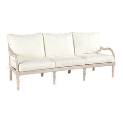 Ballard Designs - Ceylon Whitewash Sofa - Coordinates with our Ceylon Whitewash Outdoor Collection. Basic sand cushions included. Eucalyptus wood suitable for covered outdoor use. Assembly required. Replacement cushions available. Requires 3 replacement cushion sets per sofa. With its refined, hand-carved details, our Ceylon Sofa captures the relaxed elegance of classic British Colonial style. The Ceylon Whitewash Collection is crafted of sturdy FSC certified eucalyptus wood to resist harsh weather and damaging insects. Small cracks may develop and are considered a natural characteristic of this durable wood.Ceylon Sofa features: . . . . . Use of an outdoor furniture cover is recommended to extend the life of your piece.