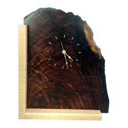 Natural Edge Figured Walnut Wood Mantel Clock with Turquoise Inlay - This clock is made of figured walnut. We left the beautiful natural edge of the walnut and sealed it with a natural finish to protect it. The face of this beautiful clock has turquoise inlay that marks each hour. The figured maple base down the left side and bottom of the clock adds a stunning accent to this unique timepiece.