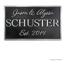 """Family Name Wedding Plaque 20"""" x 12"""" in Pewter Finish - First there was two, now there is one. The Family Name Wedding Plaque celebrates the blending of two different names into one. This wedding gift plaque gives prominence to the family name in a bold font. The family name is framed in with the first names of the lucky couple and their most significant date, done in a nice soft script font. Very attractive and well balanced."""