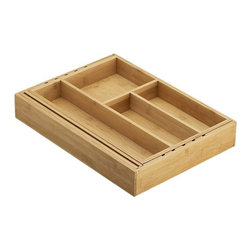 "Expandable Bamboo Gadget Tray - All the right spaces for gadgets in renewable bamboo. Adjustable tray expands to fit almost any kitchen drawer and includes two additional dividers to customize the compartments. Plus, a patented ""loc-a-ball"" system locks the desired width in place so everything stays put."