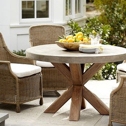 "Abbott Round Concrete Top Dining Table & Saybrook Chair Set - The rugged, casual look of concrete creates a handsome contrast to our table's eco-friendly, solid eucalyptus base. Patterned after the wicker porch furniture once found throughout the American South, the high-backed Saybrook Dining Chairs add welcoming outdoor comfort. Click to read an article on {{link path='pages/popups/saybrook-care_popup.html' class='popup' width='640' height='700'}}recommended care{{/link}}. Table: 48"" diameter, 30"" high Chair: 23"" wide x 27"" deep x 37"" high Crafted of eucalyptus with a concrete top. Chairs include a quick-drying seat cushion with a water-repellent polyester canvas slipcover in Natural; imported. Get a colorful update with additional slipcovers (sold separately) in water-repellent, ring-spun polyester canvas, or fade and stain-resistant Sunbrella(R) fabric; imported. Sunbrella(R) cushions and slipcovers are special order items which receive delivery in 34 weeks. Please click on the shipping tab for shipping and return information. View our {{link path='pages/popups/fb-outdoor.html' class='popup' width='480' height='300'}}Furniture Brochure{{/link}}."