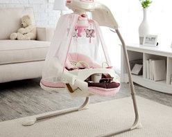 Fisher-Price Butterfly Cradle Baby Swing - Give your little princess the throne she deserves with the Fisher-Price Butterfly Cradle Swing. Decked out in pink with flowers and butterfly details this precious swing will soothe and delight Baby. While comfortably cradled in the cozy papasan seat with head support cushion your baby can swing either side-to-side or front-to-back depending on her changing preferences. Your wide awake infant will enjoy watching the spinning mobile playing with the bead bar on the removable tray and listening to the cheerful songs and nature sounds. When it's naptime Mom can switch on the butterfly light show that projects onto the sheer canopy and play another set of calming songs or sounds. Additional Features for Baby: Watching butterfly light show and motion of moving flowers on the mobile fosters visual tracking skills Canopy surrounds baby and sways along with the swing Comfy cradle seat with head support provides baby with a sense of security Daytime and nighttime songs and sound effects with volume control strengthen baby's auditory skills and provide variety Alternating swinging motions calm your baby Additional Features for Mom and Dad: Sturdy steel frame folds for storage and portability Removable papasan seat pad is machine-washable 6 speeds and 2-position reclining seat for comfort as baby develops Customize baby's experience by choosing lights on or off music only swinging only mobile only or any combination Quick-release power cord saves on batteries; requires 4 D batteries (not included) Weight capacity: 25 lbs. Developmental Guidelines: Use cradle swing from birth until baby becomes active and can climb out of the seat. Recommended ages: Birth-12 months. About Fisher-PriceAs the most trusted name in quality toys Fisher-Price has been helping to make childhood special for generations of kids. While they're still loved for their classics their employees' talent energy and ideas have helped them keep pace with the interests an