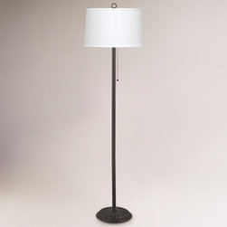 World Market - Durham Floor Lamp - Refined simplicity defines the Durham Floor Lamp, making it an ideal choice for a wide variety of decorating choices from modern to Main Street. We love the added carved details on the base, and the crisp, off-white shade that makes the lighting even lovelier. Combined with the striking, clean lines of the entire design, this lamp illuminates your space with style.