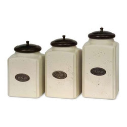 Ivory Canisters - Set of 3 - An aged cream finish gives this canister set a classic look. Each canister has a brown lid and features its own content label. for storing your sugar, cookies and flour, this set of ceramic canisters is perfect. Food safe.