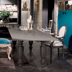 London Glass Top Dining Table - London dining table by Moda, made in Italy. This designer dining table is solid, masculine, and oozes sophistication and class. London modern dining table has a glass top that can be finished in transparent, or matt lacquered. Leg finishes: black vintage, light vintage or matt lacquered as per picture. This table can be also made in any custom size (extra 265 pounds) or finish. Email us at ilive@imagine-living.com for details.