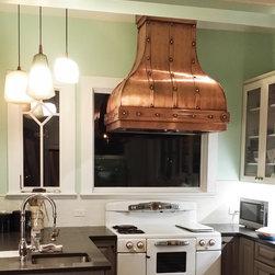 Custom Island Camillia Range Hood - Island Copper Range Hood installed in a beautiful vintage style kitchen.