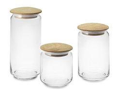Glass Canisters With Wood Lids - I love my glass countertop jars. One holds flour, one holds sugar and the third holds dog biscuits.