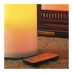 "Frontgate - Remote for Battery-operated Outdoor Flameless Candle - The remote (sold separately) controls candles within a 12' radius. Crafted from all-weather resin that looks like real wax. Won't melt, even in extreme temperatures. Patented wick provides an ultra-realistic look. Operates without fire, smoke or soot. Controlled by a convenient remote, our Battery-operated Flameless Outdoor Candles create instant ambiance with the touch of a button. These candles have the realistic, flickering glow of a real candle without the mess or worry. A 24-hour timer with 5- and 10-hour modes turns candles on or off at the same time each evening.  .  . . . . Safe around children and pets . Each candle operates on 2 ""D"" batteries, not included . Flickers up to 2,000 hours on a single set of batteries . Drain holes allow moisture to drain out. Miniature drain holes allow moisture to drain out . . Patented, realistic looking wick. Rust-resistant stainless steel housing protects interior circuitry . For indoor or outdoor use . Note: Not for use with spiked candleholders."