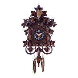 River City Cuckoo Clocks - One Day Hand-Carved Cuckoo Clock with Intricate Leaves and Vines - This hand-carved German cuckoo clock features intricately carved leaves and vines.  It has wooden hands, a wood dial with Roman numerals, and a warm light yellow hand-painted and hand-carved cuckoo bird.  Two cast iron pine cone weights are suspended beneath the clock case by two separate brass chains.  -The hand-carved maple leaf pendulum continously swings back and forth which controls the timing of the clock. If your cuckoo clock's timing should ever need adjustment, you can control the speed of your clock by sliding the maple leaf up or down the pendulum stick. Sliding the maple leaf down causes the cuckoo clock to run slightly slower, while sliding the maple leaf up makes the cuckoo clock run slightly faster.  -  -On every hour the cuckoo bird emerges from a swinging door above the clock dial and counts the hour by cuckooing once per hour. (Example: At one o'clock the bird will cuckoo once. At eight o'clock the bird will cuckoo eight times) The half hour is announced with one cuckoo call.   -  -The 30 hour all brass mechanical Regula movement, which is produced in the Black Forest of Germany, is wound once per day by raising the two pine cone weights. One weight powers the time and the other weight powers the cuckoo and cuckoo call.  -Great effort has been made to portray each cuckoo clock as accurately as possible.   -As with many handmade items, the exact coloration and carving may vary slightly from clock to clock. We consider this to be a special part of their character.  This clock is covered by a two year limited warranty covering workmanship and manufacturers defects. River City Cuckoo Clocks - 27-14