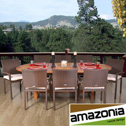 Amazonia - OS Corsica 9-piece Dining Set - Enjoy your backyard with a nine-piece outdoor dining set that is ideal for dinner parties under the evening sky. The table is made of lightly stained eucalyptus wood and includes eight cushioned wicker chairs for stylish comfort that is sure to impress.