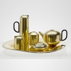 Form Tea Set - How gorgeous is this tea set designed by Tom Dixon? The brass finish and the stepped shape of the tray are modern touches on a set that looks like it's straight out of the '60s.