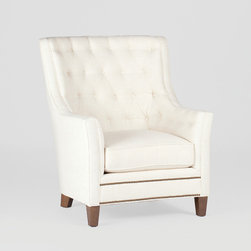 Welch Chair by Gabby - Relax and slip into something comfortable. This modernized wingback features clean lines, and a hand tufted back.  A double row of nailheads line the front and aide in refining this sophisticated look. Available in a wide variety of fabrics and finishes, including your choice of 5 different nailhead designs and 3 leg finish options.