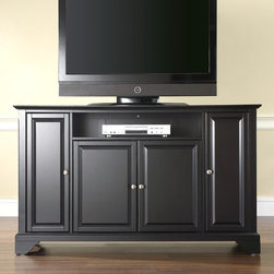"Crosley - LaFayette 60"" TV Stand - Enhance your living space with one of Crosley's impeccably-crafted TV stands. This signature cabinet accommodates most 60'' flat panel TVs and is handsomely proportioned featuring character-rich details sure to impress. Raised panel doors strategically conceal stacks of CDs/DVDs, gaming components and various media paraphernalia. Open storage area generously houses media players and the like. Adjustable shelving offers an abundance of versatility to effortlessly organize by design, while cord management systems tame the unsightly mess of tangled wires. Customize our distinct cabinets by selecting one of four collection styles (featuring tapered, traditional. turned or bun feet) in your choice of one of three signature Crosley finishes. This customizable cabinet approach is designed for easy assembly, built to ship and constructed to last. Features: -Raised panel doors.-Five adjustable shelves for storing electronic components, gaming consoles, DVDs and other items.-Adjustable levelers in legs.-Recommended TV Type: Flat screen.-TV Size Accommodated: 60"".-Powder Coated Finish: No.-Gloss Finish: No.-Material: Hardwood and veneers.-Solid Wood Construction: No.-Distressed: No.-Exterior Shelves: Yes -Number of Exterior Shelves: 1.-Adjustable Exterior Shelves: No..-Drawers: No .-Cabinets: Yes -Number of Cabinets: 3.-Number of Doors: 4.-Door Attachment Detail: Pin hinge.-Interchangeable Panels: No.-Magnetic Door Catches: Yes.-Cabinet Handle Design: Knob.-Number of Interior Shelves: 5.-Adjustable Interior Shelves: Yes..-Scratch Resistant : No.-Removable Back Panel: No.-Hardware Finish (Finish: Black): Brushed nickel knobs, steel hardware.-Hardware Finish (Finish: Classic Cherry, Vintage Mahogany): Antique brass knobs, steel hardware.-Casters: No .-Accommodates Fireplace: No.-Fireplace Included: No .-Lighted: No .-Media Player Storage: Yes.-Media Storage: No .-Cable Management: Hole in back for wires.-Remote Control Included: No.-Batteries Required: No .-Weight Capacity: 200 lbs.-Swatch Available: No.-Commercial Use: No.-Collection: Alexandria.-Eco-Friendly: No.-Recycled Content: No .-Lift Mechanism: No.-Expandable: No.-TV Swivel Base: No.-Integrated Flat Screen Mount: No.-Hardware Material: Steel.-Product Care: Use a soft clean cloth that will not scratch the surface when dusting. Use of furniture polish is not necessary. Should you choose to use a furniture polish, test in an inconspicuous area first. Use os solvents of any kind could damage your furniture's finish. To clean, simply use a soft cloth moistened with lukewarm water, then buff with a dry soft clean cloth..Specifications: -ISTA 3A Certified: Yes.-FSC Certified: No.-General Conformity Certified: No.-CSA Certified: No.-EPP Certified: No.Dimensions: -Overall Height - Top to Bottom: 30"".-Overall Width - Side to Side: 59.75"".-Overall Depth - Front to Back: 18"".-Drawer: .-Shelving: Yes.-Cabinet: -Cabinet Interior Height - Top to Bottom: 22.5"".-Cabinet Interior Height - Top to Bottom: 29.25"".-Cabinet Interior Width - Side to Side: 31.2"".-Cabinet Interior Width - Side to Side: 12"".-Cabinet Depth - Front to Back: 14.75""..-Legs: Yes.-Overall Product Weight: 123 lbs.Assembly: -Assembly Required: Yes.-Tools Needed: Allen wrench (included) and screwdriver.-Additional Parts Required: No .Warranty:"