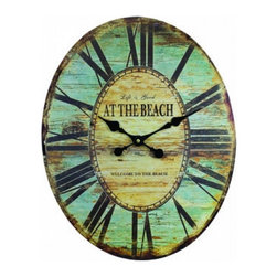 Handcrafted Nautical Decor - Wooden Vintage At The Beach Wall Clock 19'' - Lose     track of time in this idyllic coastal scene Wooden Vintage At The Beach Wall Clock 19''. If you are looking for ideas for decorating a beach house, then look no further.  This  Wooden Vintage At The Beach Wall Clock 19'' will serve as the perfect beach decoration to compliment your home. This lighthearted timepiece perfectly suits any beach decor, beach house theme or nautical decor.--19'' Long x 1'' Wide x 19'' High----    Displays the words At The Beach on the face of the clock--    --    Excellent beach house decoration--    Perfect for any kitchen, den or sunroom--    Clock requires one AA battery (not included)--
