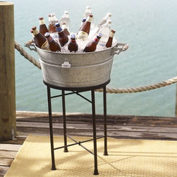 Rivet Galvanized Metal Party Bucket & Stand - I am a huge fan of drink stands. I use one at each party that I throw, and this galvanized version is a classic and a huge nod to the beach. I love how relaxed and casual it feels.