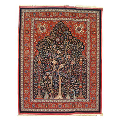 Amoghl - Mashhad Amogli Rug - This silk warps, wool pile niche design rug was woven by the famous Amoghli shops in Meshad and is signed in the upper border. This rug was woven in the 1940′s. The weave is extremely fine faraway knotted pile rug, 1369 knots per sqauere inch. The standard Emoghli density is about 900 knots per square inch. The rug must have been either a special order or a show piece of the workshop technical prowess. The navy blue prayer field has a main tall tree and sinuous secondary tall plants growing from the inside edge of the flower border,along with two side columns gracefully supporting the arch. The red spandrels display each a large silk palmette together with complex arabesques. The red main border is decorated with connected palmetts. As is the case with all true Amogli creations, there is a wide purple silk flat-weave on all four sides. the condition is exemplariy, as if the rug has been stored away or hung away from light.