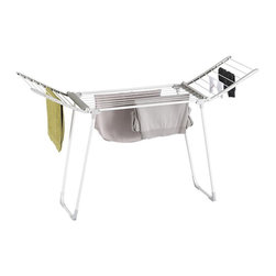 Deluxe Folding Drying Rack   Crate&Barrel - This hefty drying rack fits in most tubs, so it's out of the way and drips can simply slide down the drain. It holds a lot of items at once, but folds away to take up minimal space.