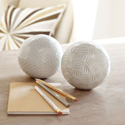 Textured Ceramic Spheres - Investing in inexpensive accessories like these textured balls will add tons of personality to a bookcase or grouped together in a large wood bowl.