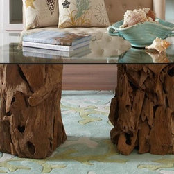 Driftwood Coffee Table - One-of-a-kind driftwood brings intrigue and beauty to this table. Bring the calm of the seaside to your everyday life.