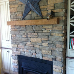 Fireplace Mantels - Adding a faux wood mantel allows you to break up the space and draw the eyes, creating a simple, elegant design.