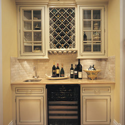Solid Wood Stemware Rack - Omega National's solid wood Stemware Rack is designed to display your beautiful and valuable stemware collection. Accommodates most stemware styles. Mounts directly to underside of cabinet. Pass through design allows access from both sides in all applications.