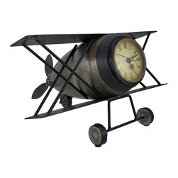 Antique Metal Biplane Table or Shelf Clock - This metal biplane clock adds an antique accent to any table or shelf in your home or office. Made of metal, it measures 7 inches high, 9 3/4 inches long, and 12 1/4 inches wide. The plastic clock face measures approximately 2 3/4 inches in diameter and features Roman numerals and decorative black hands to mark the time. Pull the clock face straight out to set the time and install 1 AA battery (not included). This clock is a great conversation piece, and makes a great gift for aviation enthusiasts.