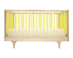 """Kalon Studios - Kalon Studios Caravan Crib Yellow - Kalon Studios designs nursery furniture with a focus on contemporary form, innovative style and sustainability. Inspired by a storybook circus wagon, the Caravan crib offers playful and modern elements. This minimalist baby furnishing features yellow slatted sides, two adjustable mattress heights and the option to convert to a platform toddler bed. Made in the USA from FSC-certified maple and low VOC, HAPs-free paint. Due to handmade and natural quality, slight color and grain variation may be present. 54.5""""W x 30""""D x 34""""H. Fits standard crib mattress (not included). Conforms to ASTM, CPSC and Health Canada regulations. Glue contains zero formaldehyde and exceeds European E1 and California emission standards by 3 times. Green guard certified."""