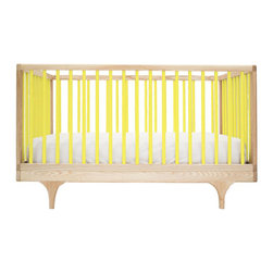 "Kalon Studios - Kalon Studios Caravan Crib Yellow - Kalon Studios designs nursery furniture with a focus on contemporary form, innovative style and sustainability. Inspired by a storybook circus wagon, the Caravan crib offers playful and modern elements. This minimalist baby furnishing features yellow slatted sides, two adjustable mattress heights and the option to convert to a platform toddler bed. Made in the USA from FSC-certified maple and low VOC, HAPs-free paint. Due to handmade and natural quality, slight color and grain variation may be present. 54.5""W x 30""D x 34""H. Fits standard crib mattress (not included). Conforms to ASTM, CPSC and Health Canada regulations. Glue contains zero formaldehyde and exceeds European E1 and California emission standards by 3 times. Green guard certified."