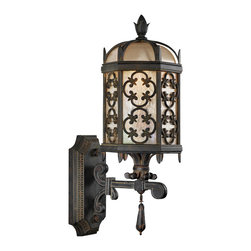 Fine Art Lamps - Costa del Sol Outdoor Wall Mount, 329881ST - How about some old-world ambience to light your way? This outdoor wall-mount light features a stylized quatrefoil design in an antiqued wrought iron finish and subtly iridescent glass to let your style light shine.