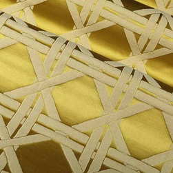 """Silk Lattice Fabric in Chartreuse - A classic canework design has been enlarged to a modern scale for this new softly shimmering chartreuse silk fabric. The motif has a raised, textured look, created by the use of """"shrink"""" yarns on its reverse side. This give the fabric dimension without sacrificing the soft appearance and hand. The ground is a luxurious satin weave of 100% silk face. Perfect for curtains, duvets, pillows and light upholstery, it is woven in soft, metal-inspired colors and a bold shade of chartreuse. Italian made from a blend of 69% Viscose, 18% Silk, and 13% Polyester. Passes 5,000 Wyzenbeek abrasion test. Repeat: 4 1/2″ H, 4 1/2″ V; Width: 53 1/4″."""