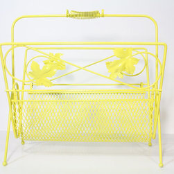 Vintage Metal Yellow Magazine Rack by Fishbone Deco - This bright yellow retro magazine will look like art and be functional as well.