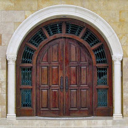Old World Collection - DbyD3008 - Talk about making a statement. This door has an impressive scale with gorgeous leaded glass and solid heavy paneled doors.
