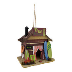 Tiki Surf Club Beach Hut Birdhouse - This awesome beach hut birdhouse adds a cute accent to your home or out in your yard. It features a straw roof, scattered surfboards, sand, and even a tiny bonfire. Made of wood, it measures 9 1/2 inches tall, 9 1/2 inches long, and 6 1/2 inches wide. It has a 1 1/4 inch diameter opening with a 3/4 inch perch, plus a side entrance. It has a 6 1/2 inch drop from the twisted rope hanger.