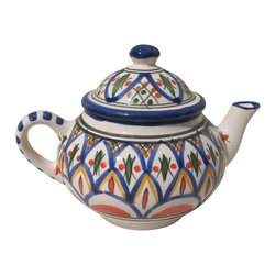 Le Souk Ceramique - Tabarka Teapot - 24 Fluid Ounces. Hand Made . Dishwasher safe . Microwave safe . Made in Tunisia. Lead free glazes . Meets CA Prop 65 . Meets all Federal StandardsNamed in part for the beautiful Tunisian seaside resort town of Tabarka where the red tile roofs of the Mediterranean beach bungalows dot the coastline, our Tabarka pattern is an elaborate blend of Italian, French and Arabic styles that throughout history have also shaped it's namesake city. Shades of fire red, goldenrod, grass green and cobalt blue are set against a white background creating a sumptuous and vibrant pattern perfect for any occasion.