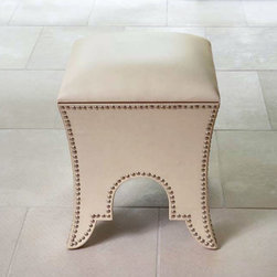 "Global Views - Global Views Moroccan Beige Leather Poof - An ottoman with global flair, Global Views' structured Moroccan pouf in beige leather does double duty as a foot rest and storage piece. Its sides are embellished with nailhead trim following the curves of its Moorish-inspired silhouette. 16"" Square x 20""H; Cowhide leather; Top opens for storage"