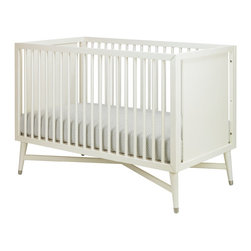 DwellStudio - Midcentury Crib, French White - This crib doesn't provide storage, but it makes up for it with the prettiest legs you ever did see. It's a great transitional piece that would be at home in a traditional or modern space.