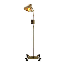 Vintage Medical Floor Lamp - This great looking floor lamp, originally made as a therapeutic heat lamp, we have converted it to accept standard bulbs. The light has some rust and a few scratches, and is perfectly vintage. This lamp is a real throw back, circa 1950's medical quackery. A light like this is would look great in any vintage, industrial, or modern style house.